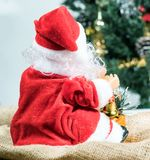 Behind the Santa Claus and Christmas tree background. Royalty Free Stock Image