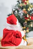 Behind the Santa Claus and Christmas tree background. Royalty Free Stock Photo