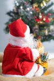 Behind the Santa Claus and Christmas tree background. Stock Images