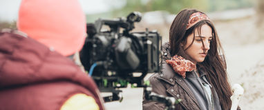 Behind the scene. Actress in front of the camera. On the film set outdoor location. Group movie scene Stock Photos