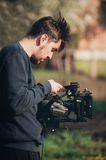 Behind the scene. Cameraman shooting film scene with his camera Royalty Free Stock Photo