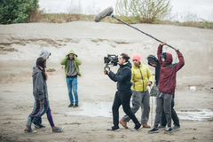 Behind the scene. Film crew filming movie scene outdoor. Behind the scene. Film crew team filming movie scene on outdoor location. Group cinema set royalty free stock image