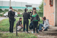 Behind the scene. Film crew filming movie scene outdoor. Behind the scene. Film crew team filming movie scene on outdoor location. Group cinema set Royalty Free Stock Photography