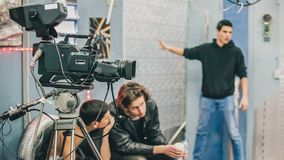 Behind the scene. Film crew filming movie scene in studio. Behind the scene. Film crew team filming movie scene on studio. Group cinema set royalty free stock photography