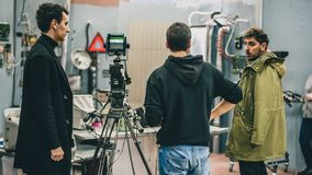 Behind the scene. Film crew filming movie scene in studio royalty free stock images