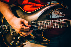 Behind scene. Guitarist practice playing guitar in messy music s. Behind the scene. Male guitarist artist musician practice playing guitar in messy recording stock image