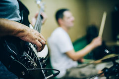 Behind scene. Rock band practice in messy recording music studio Royalty Free Stock Photography