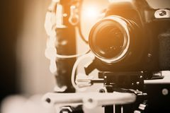 Behind the scenes. Detail of Video camera, film crew production, behind the scenes background stock photo