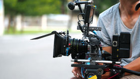 Behind the scenes of movie shooting or video production. Behind the scenes of movie shooting or video production and film crew team with camera equipment at Stock Photo