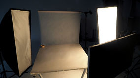 Behind the scenes of shooting video production. Behind the scenes of shooting video production in a studio with small set of professional lighting equipment Stock Photos