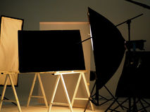 Behind the scenes of shooting video production. Behind the scenes of shooting video production in a studio with small set of professional lighting equipment Stock Images
