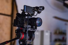 Behind the scenes of video production or video shooting. At studio location with film crew camera team Stock Photography