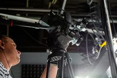 Behind the scenes of video production or video shooting. At studio location with film crew camera team Stock Photo