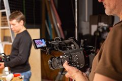 Behind the scenes of video production or video shooting. At studio location with film crew camera team Royalty Free Stock Photo