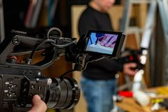 Behind the scenes of video production or video shooting. At studio location with film crew camera team Stock Images