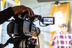 Behind the scenes of video production or video shooting. At studio location with film crew camera team royalty free stock images