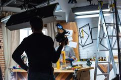 Behind the scenes of video production or video shooting. At studio location with film crew camera team Royalty Free Stock Image
