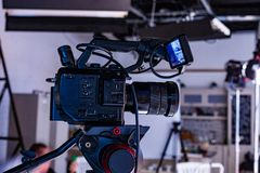 Behind the scenes of video production or video shooting. At studio location with film crew camera team stock image
