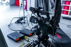 Behind the scenes of video production or video shooting. At studio location with film crew camera team. Film grain effect Royalty Free Stock Photography