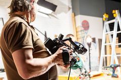 Behind the scenes of video production or video shooting. At studio location with film crew camera team Royalty Free Stock Photography