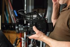Behind the scenes of video production or video shooting. At studio location with film crew camera team Stock Photos