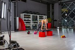 Behind the scenes of video production or video shooting of woman in sportswear doing crossfit. Behind the scenes of video production or video shooting at studio stock photography