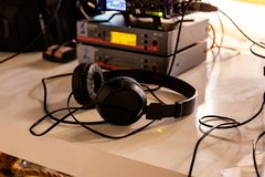 Behind the scenes of video production or video shooting. headphones, video equipment. Behind the scenes of video production or video shooting at studio location Royalty Free Stock Images
