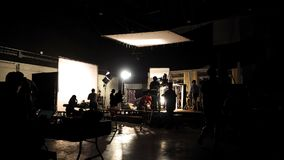 Behind the scenes of video shooting production crew team silhouette stock images