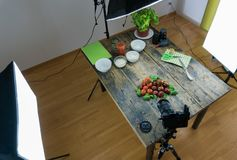 Behind the scenes view of home studio food photography with equipment. Top down behind the scenes view of home studio food photography with lighting equipment royalty free stock image