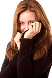 Behind the sweater. Beautiful woman hides a smile behind her sweater Stock Photos