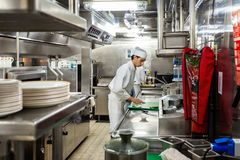 Free Behind The Scenes View Of Food Preparation In The Kitchen, Galley On Board A Large Cruise Ship At Sea In Queen Victoria Royalty Free Stock Images - 155607469