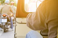 Behind of tuktuk driver in bangkok. The Motorized Tricycle are a popular way to transport in bangkok Thailand royalty free stock image