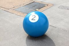 Behind the Two Ball. Huge round concrete ball marked with the number 2. A smaller version of this ball would normally be associated with the game of pool Royalty Free Stock Photos