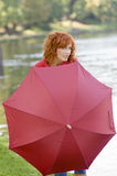 Behind the umbrella Royalty Free Stock Images