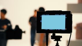 Behind video production digital view screen. Behind video production digital view screen monitor from movie shooting camera in the studio Royalty Free Stock Photos