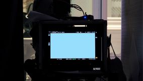 Behind video production digital view screen. Behind video production digital view screen monitor from movie shooting camera in the studio Stock Image