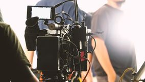 Behind the video shooting production team working. Behind the video shooting production crew team working and set of full hd camera equipment in studio Stock Images