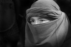 Behind a viel. Image of a young woman behind a veil Stock Image
