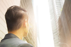 Behind view of an Asian businessman looking up. Stock Photo