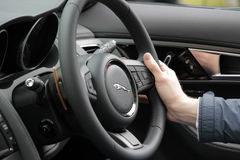 Behind the wheel in Jaguar Royalty Free Stock Photo