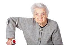 Behinderte ältere Frau mit Krücke lizenzfreie stockbilder
