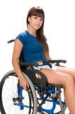 Behinderte Frau auf Rollstuhl Stockbild