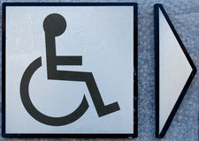 Behindertes Symbol mit Pfeil Stockfoto