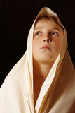 Behold. Humble child in simple cloth lifting up his eyes to heaven Royalty Free Stock Photography