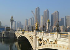 Western style  bridge on HaiHe river. The western style bridge on HaiHe river Tianjin China and  the high-rises along the river bank Stock Photo