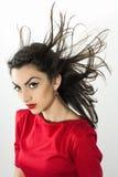 Donna che ondeggia i suoi capelli Fotografie Stock