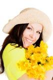 Bei fiori della holding della donna della sorgente sopra bianco Fotografie Stock