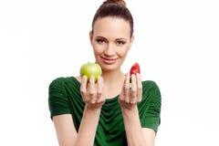 Bei frutti della tenuta della ragazza su fondo bianco Fotografia Stock Libera da Diritti