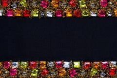 Bei gioielli su fondo nero con il posto per testo Fotografia Stock