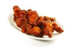 Bei pezzi fritti nel grasso bollente cinesi del porco Fotografie Stock Libere da Diritti